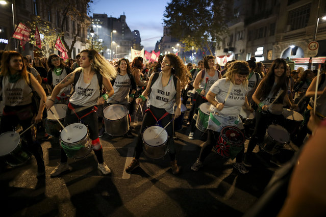 "Women play drums during a protest against gender violence in Buenos Aires, Argentina, Monday, June 3, 2019. The grassroots movement ""Ni una menos"", or Not One Less, is marking its fourth anniversary by remembering the hundreds of women who have been murdered since its founding, and demanding laws to curb sexist violence that continues to permeate Argentine society. (Photo by Natacha Pisarenko/AP Photo)"