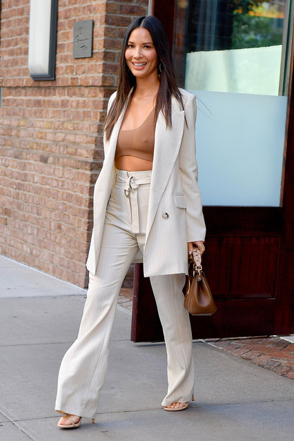 American actress Olivia Munn wears a brown crop top in New York City on June 26, 2019. (Photo by Robert O'Neil/Splash News and Pictures)