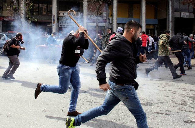 Farmers clash with riot policemen during a protest outside the Greek Agriculture Ministry on March 8, 2017 in Athens, Greece. (Photo by Milos Bicanski/Getty Images)