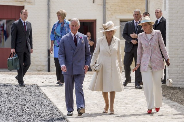 Britain's Prince Charles and Camilla, the Duchess of Cornwall, walk with Belgium's Princess Astrid (R) during a ceremony for the opening of the Hougoumont farm as part of the bicentennial celebrations for the Battle of Waterloo, near Waterloo, Belgium June 17, 2015. The commemorations for the 200th anniversary of the Battle of Waterloo will take place in Belgium on June 19 and 20. REUTERS/Geert Vanden Wijngaert/Pool
