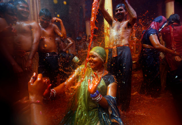 """A man throws water on a woman during """"Huranga"""", a game played between men and women a day after Holi, at Dauji temple near Mathura, March 14, 2017. (Photo by Adnan Abidi/Reuters)"""