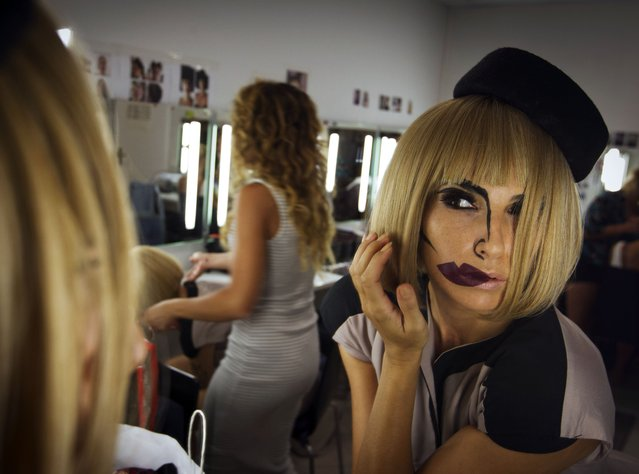 "A woman gets ready for her performance at the backstage of the Heart restaurant in Ibiza on June 29, 2015. Take the Spanish chefs Ferran and Albert Adria, the Cirque du Soleil founder French Guy Laliberte and contemporary artists such as Japanese Takashi Murakami. Put them together on the luxurious Mediterranean island of Ibiza and shake well to get ""Heart"" an innovative multi-sensory experience. (Photo by Jaime Reina/AFP Photo)"