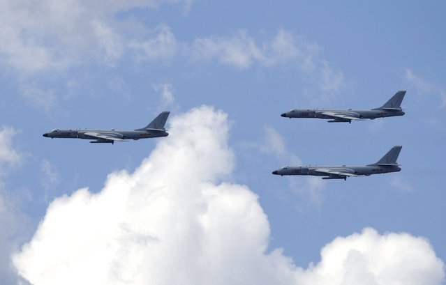 B-6k strategic bomber aircrafts of the Chinese Air Force fly in formation during a training session for the upcoming parade marking the 70th anniversary of the end of World War Two, on the outskirts of Beijing, July 2, 2015. (Photo by Jason Lee/Reuters)