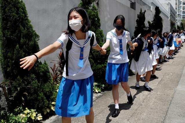 """Secondary school students form a human chain against extradition bill in Hong Kong, September 3, 2019. Hong Kong school and university students boycotted classes and held rallies for a second straight day, calling for what protesters call their """"five demands"""". Other than the formal withdrawal of the extradition bill, protesters want the retraction of the word """"riot"""" to describe rallies, the release of all arrested demonstrators, an independent inquiry into the police and the right for Hongkongers to democratically choose their own leaders. (Photo by Tyrone Siu/Reuters)"""