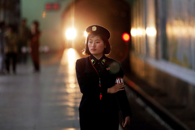 A subway worker walks away after a train departed the station in central Pyongyang, North Korea May 7, 2016. (Photo by Damir Sagolj/Reuters)
