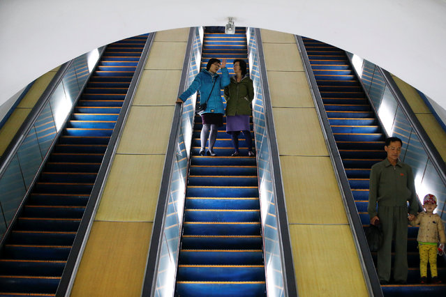 People travel on escalators to enter a subway station in central Pyongyang, North Korea on April 14, 2017. (Photo by Damir Sagolj/Reuters)