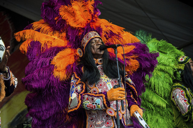 Big Chief Monk Boudreaux of Big Chief Monk Boudreaux & the Golden Eagles Mardi Gras Indians performs at the New Orleans Jazz and Heritage Festival on Sunday, April 30, 2017, in New Orleans. (Photo by Amy Harris/Invision/AP Photo)