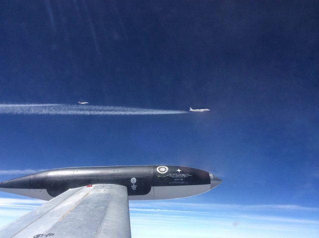 A undated handout picture made available by National Research Council of Canada on 13 May 2014, taken from the CT-133 aircraft of NASA's research partner National Research Council of Canada, showing the NASA HU-25C Guardian aircraft flying 250 meters behind NASA's DC-8 aircraft before it descends into the DC-8's exhaust plumes to sample ice particles and engine emissions. (Photo by EPA/National Research Council of Canada)