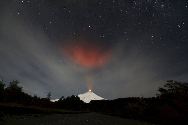 Smoke rises from Villarrica volcano as seen near the town of Pucon in southern Chile, in this June 23, 2015 file photo. (Photo by Andres Stapff/Reuters)