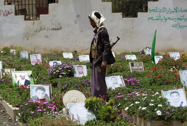 A Yemeni Huthi supporter visits a cemetary in Sanaa, on March 25, 2016. Despite the Saudi-led coalition military operation in Yemen entering its second year on March 26, 2016 the Shiite rebels are yet to be weakened and still control much of the country, where the humanitarian crisis is worsening. The UN says civilians account for more than half of the about 6,300 people killed in the conflict in the last year. (Photo by Mohammed Huwais/AFP Photo)
