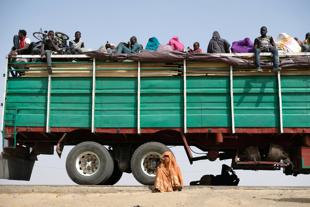 Refugees rest on, under and next to a truck in the Muna Garage area on the outskirts of Maiduguri February 16, 2017. (Photo by Paul Carsten/Reuters)