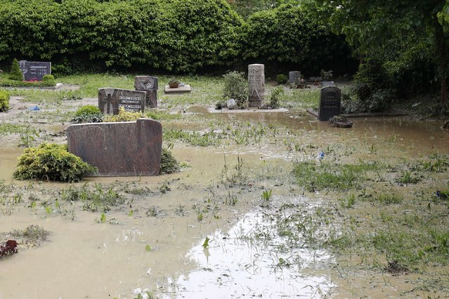A drowned graveyard is pictured after floods in the town of Braunsbach, Germany, May 30, 2016. (Photo by Kai Pfaffenbach/Reuters)