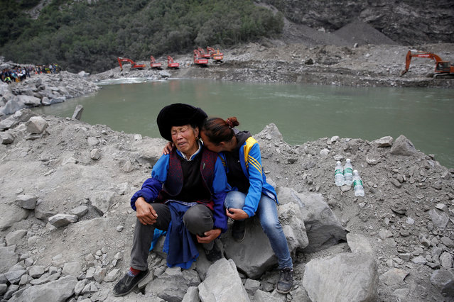 Relatives of victims react at the site of a landslide in the village of Xinmo, Mao County, Sichuan Province, China June 26, 2017. (Photo by Aly Song/Reuters)