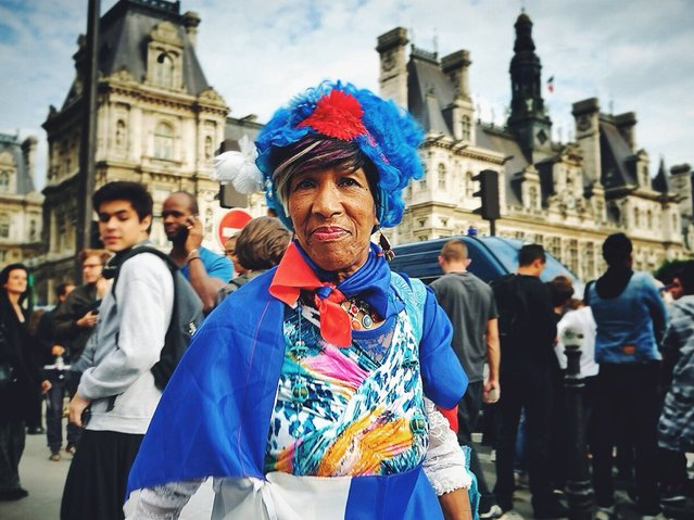 France: A woman dresses up to support her team. (Photo by Anthony Lepinay)