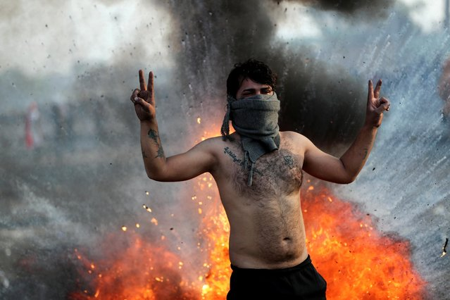 An Iraqi demonstrator gestures during ongoing anti-government protests in Baghdad, Iraq on January 20, 2020. (Photo by Thaier al-SudanI/Reuters)