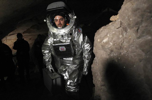 Physicist Daniel Schildhammer wears the Aouda.X spacesuit simulator during a field test inside Austria's Dachstein ice caves on April 28, 2012