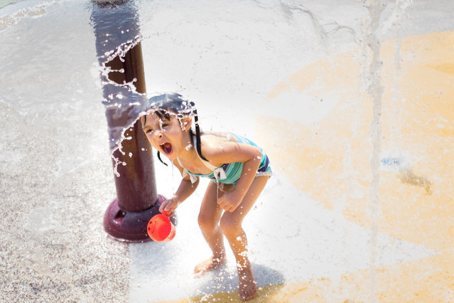 Sydney Spisman, 4, of DC plays in the water feature. On the hot afternoon of Wednesday July 12, 2017 children play at the Takoma Park Playground at 300 Van Buren St. NW in Washington, DC. (Photo by Sarah L. Voisin/The Washington Post)
