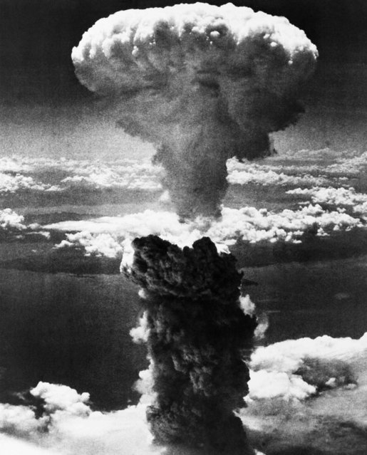 A mushroom cloud rises moments after the atomic bomb was dropped on Nagasaki, Japan, August 9, 1945. (Photo by AP Photo)
