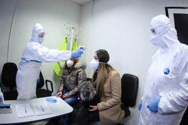 Health authorities take part in a drill to prepare for the potential arrival of passengers infected with the coronavirus at Sofia airport, Bulgaria, February 25, 2020. (Photo by Dimitar Kyosemarliev/Reuters)