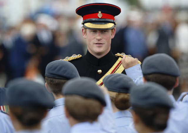 "Britain's Prince Harry speaks with cadets during a ""Step Short"" ceremony to mark the 100th anniversary of the outbreak of World War One (WW1), in Folkestone, in southern England August 4, 2014. (Photo by Luke MacGregor/Reuters)"