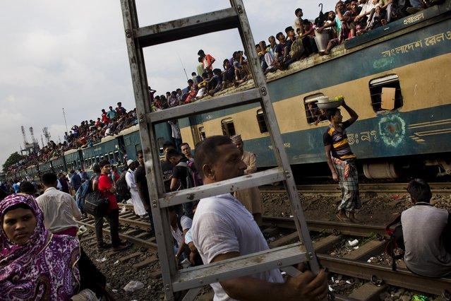 Bangladeshi Muslims travel on an overcrowded train as they head to their hometowns ahead of Eid al-Adha in Dhaka, Bangladesh, Friday, September 1, 2017. (Photo by Bernat Armangue/AP Photo)