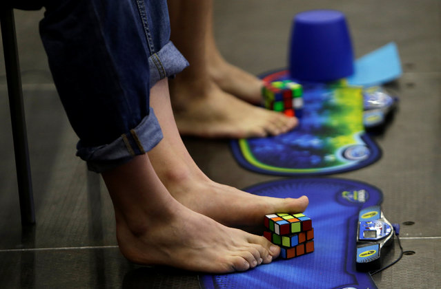 Competitors solve Rubik's cubes using their feet during the Rubik's Cube European Championship in Prague, Czech Republic, July 15, 2016. (Photo by David W. Cerny/Reuters)
