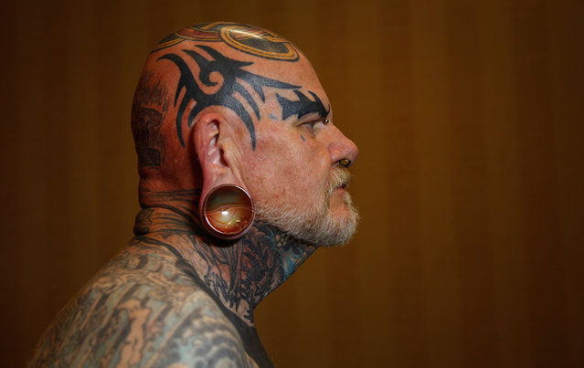 """Robert Seibert, 62, from Burlington, Kentucky, shows off his full body of tattoos, including the tribal-inspired designs he has accumulated over 40 years, during the National Tattoo Association Convention in Cincinnati, Ohio, on April 14, 2012. Of his art, Seibert says, """"I'm one of the people that can't have a favorite tattoo, each is like a certain phase of my life. To me it's a picture history of what I have gone through, through the years"""". (Photo by Jason Reed/Reuters)"""