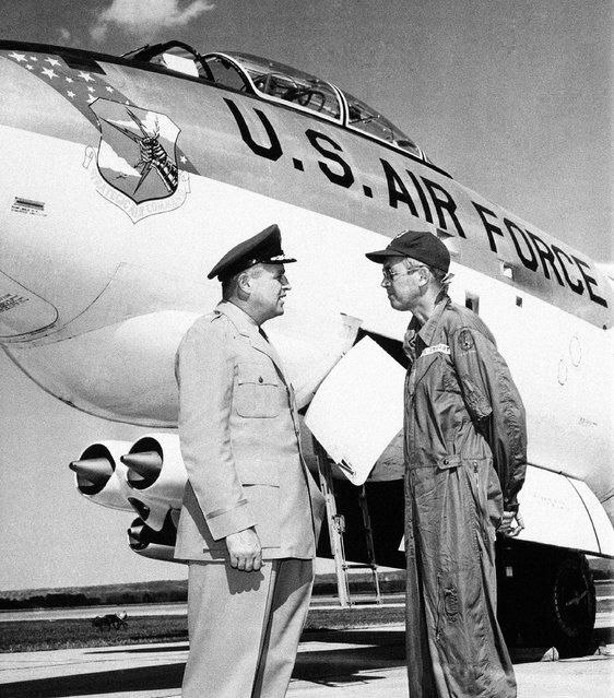 """Actor Jimmy Stewart, fresh from handling the controls of B-47 jet bomber for the first time, reports to Brig. Gen. William H. Blanchard, Strategic Air Command deputy director of operations, at Offutt Air Force Base, Omaha, Nebraska on July 11, 1956. Stewart, a reserve colonel who flew in to begin a two week duty tour, said the bomber """"flies like a bird"""". (Photo by AP Photo)"""