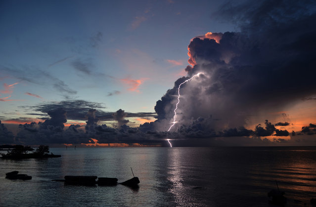 Lightning Sunset: Thunderstorms in the Florida Keys are often sporadic, short-lived, and incredibly isolated. This photo shows a small cluster of storm clouds that had blown in during a sunset on an otherwise clear day. (Photo by Judy Jinn/National Geographic Photo Contest