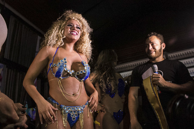Erika Canela (C) of Bahia state cries after winning the Miss Bumbum 2016 contest which elects the woman with the best looking derriere in Brazil, on November 09, 2016 in Sao Paulo, Brazil. (Photo by Daia Oliver/Brazil Photo Press/LatinContent/Getty Images)