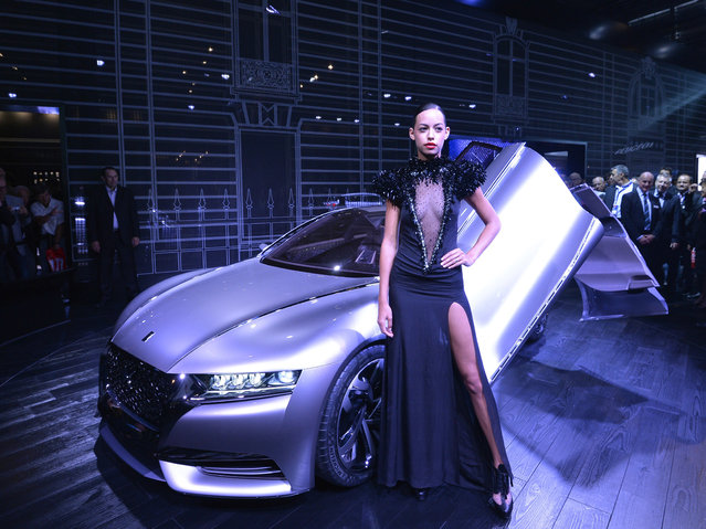 A model poses next to the new Citroen Concept Car Divine DS at the 2014 Paris Auto Show on October 2, 2014 in Paris on the first of the two press days. (Photo by Miguel Medina/AFP Photo)