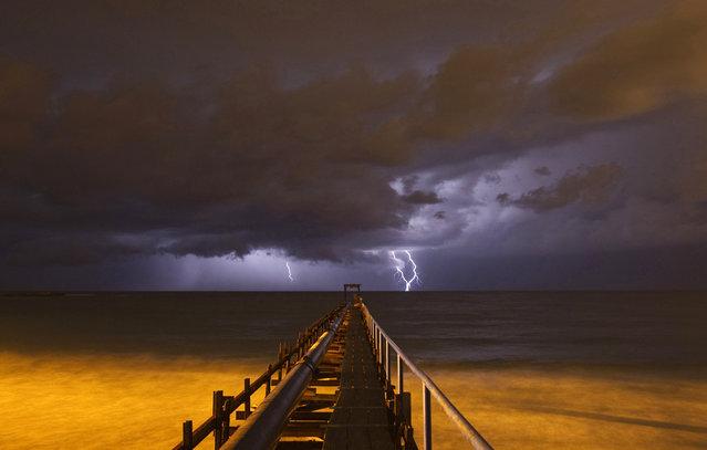 Lightning strikes in Atlit, near the northern Israeli city of Haifa on October 25, 2012. (Photo by Baz Ratner/Reuters)
