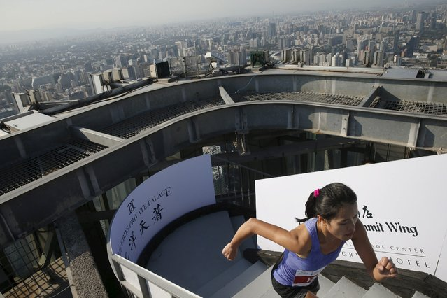 A participant runs on stairs during a vertical run event at China World Summit Wing hotel in Beijing, China, September 19, 2015. About 800 runners took part in the event on Saturday, which takes runners up 82 floors, covering a total of 2,041 steps to a height of 330 metres, the organizer said. (Photo by Kim Kyung-Hoon/Reuters)
