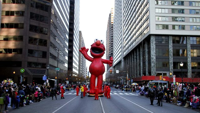 The Elmo balloon makes it's way down J.F.K. Boulevard during the 93rd annual Thanksgiving Day parade in Philadelphia.  (Photo by Joseph Kaczmarek/Associated Press)