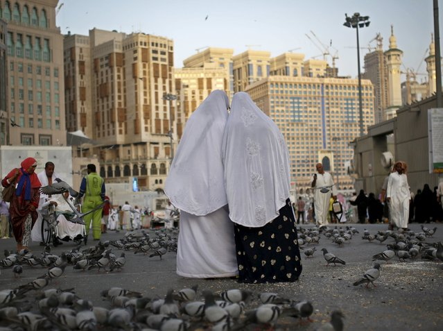 Muslim pilgrims stand outside the Grand mosque in the holy city of Mecca ahead of the annual haj pilgrimage September 21, 2015. (Photo by Ahmad Masood/Reuters)