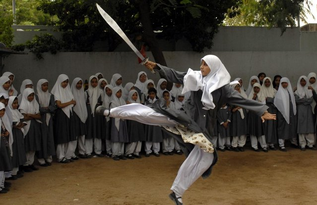A Muslim schoolgirl from St. Maaz high school practises Chinese wushu martial arts inside the school compound in Hyderabad July 8, 2008. (Photo by Krishnendu Halder/Reuters)