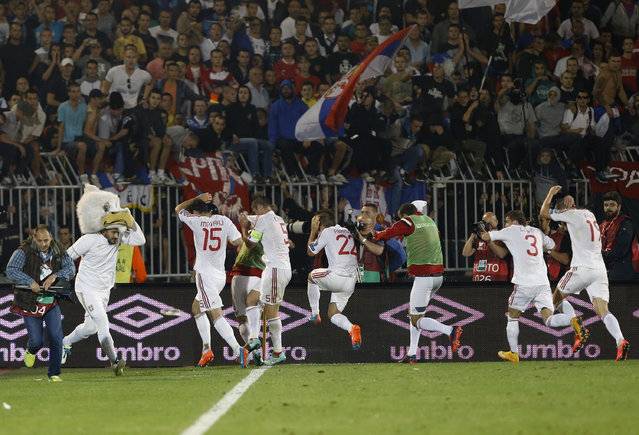 Albania's players leave the pitch during the Euro 2016 Group I qualifying match between Serbia and Albania, at the Partizan stadium in Belgrade, Serbia, Tuesday, October 14, 2014. The match was suspended after 41 minutes at 0-0. (Photo by Darko Vojinovic/AP Photo)