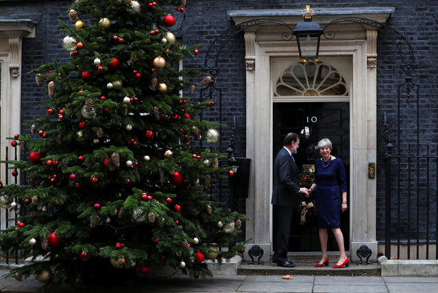 Britain's Prime Minister Theresa May greets Spain's Prime Minister Mariano Rajoy outside 10 Downing Street, London, Britain December 5, 2017. (Photo by Hannah McKay/Reuters)