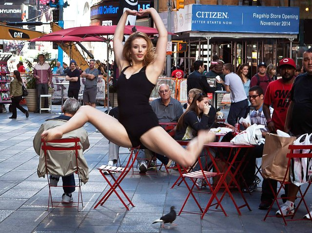 "A dancer poses for a photograph as part of the ""Dance as Art"" photo project in Times Square in New York, on September 22, 2014. (Photo by Carlo Allegri/Reuters)"