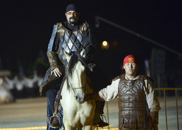 In this photo taken on Saturday, September 3, 2016, U.S. actor Steven Seagal rides a horse during the opening ceremony of the second World Nomad Games at Issyk Kul lake in Cholpon-Ata, Kyrgyzstan. (Photo by Vladimir Voronin/AP Photo)