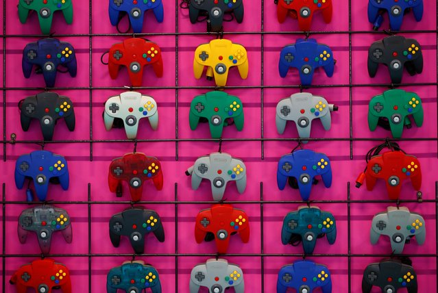 Variations of the Nintendo 64 controller are displayed during the media day of Gamescom in Cologne, Germany on August 20, 2019. (Photo by Wolfgang Rattay/Reuters)