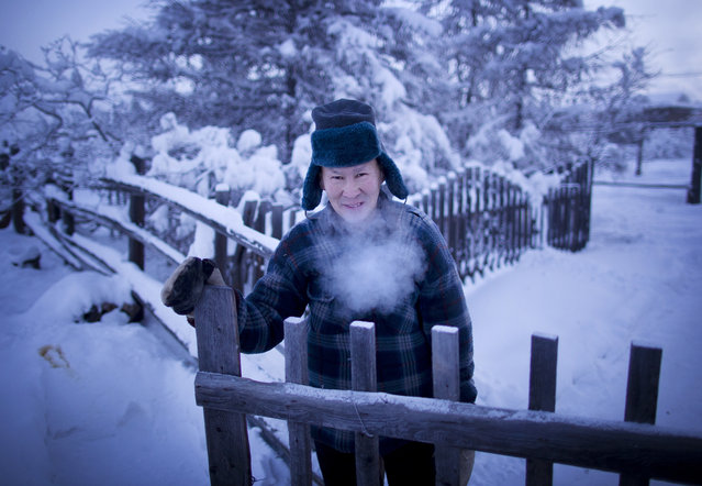 A local in Oymyakon pauses for a quick photo during a toilet run. (Photo by Amos Chapple/Courtesy Images/RFE/RL)