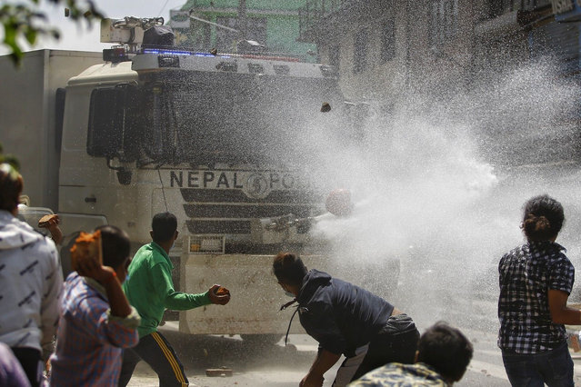Local people attack a police water cannon truck during a clash between the devotees and police in Lalitpur, Nepal, on September 3, 2020. Nepalese police interrupted the chariot festival of Rato Machhindranath amid the ban on public and religious gatherings to control the spread of COVID-19. (Photo by Chine Nouvelle/SIPA Press/Rex Features/Shutterstock)