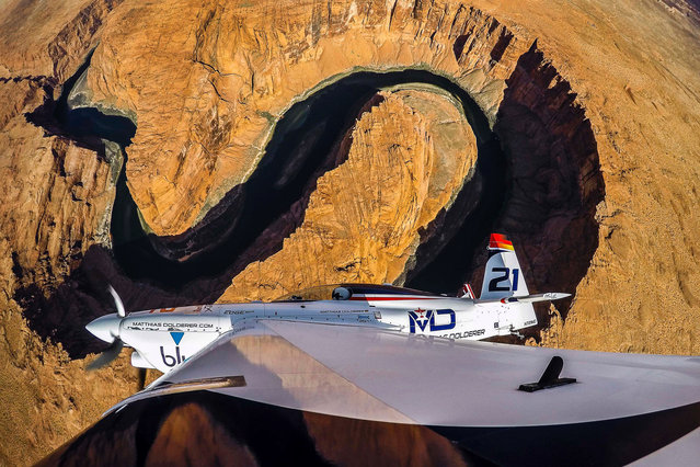 World Champion Matthias Dolderer of Germany flies over the Horseshoe Bend near Lake Powell in Page, United States during the transfer flight from Indianapolis to Las Vegas to prior the final stage of the Red Bull Air Race World Championship on October 12, 2016. (Photo by Predrag Vuckovic/AFP Photo)