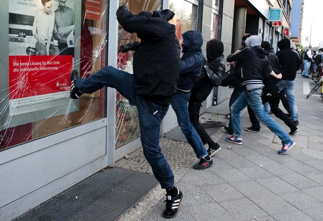 Left wing activists attack a bank during May Day demonstrations in Berlin. (Photo by Markus Schreiber/Associated Press)