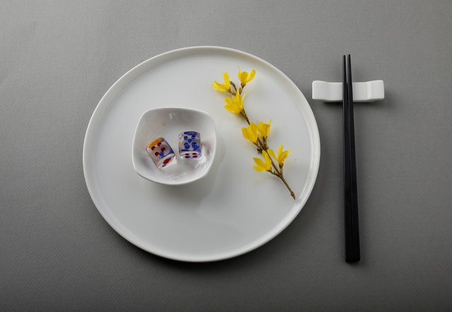 Plastic dice weighing 21 grams combined, which is equivalent to the amount of plastic that someone could eat in one month, are displayed on a plate in this illustration taken in Tokyo, Japan, March 31, 2020. (Photo by Kim Kyung-Hoon/Reuters)