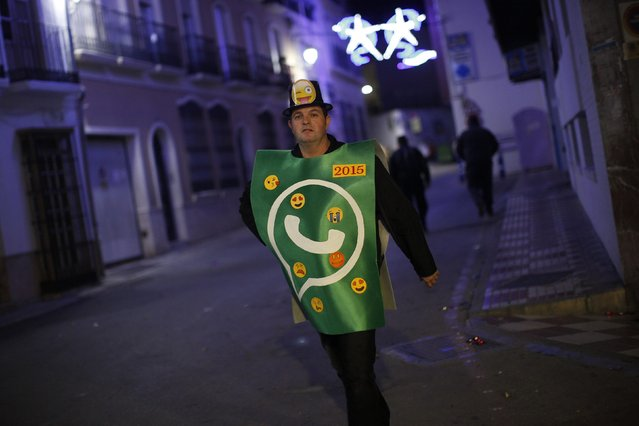 A reveller dressed up as a Whatsapp logo takes part in New Year's celebrations in Coin, near Malaga, southern Spain, early January 1, 2015. (Photo by Jon Nazca/Reuters)