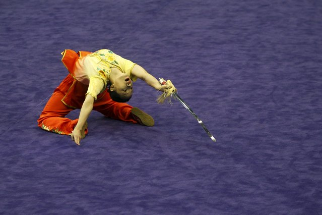 South Korea's Seo Hee-ju competes in the women's jianshu final during the 13th World Wushu Championship 2015 at Istora Senayan stadium in Jakarta, November 17, 2015. (Photo by Garry Lotulung/Reuters)
