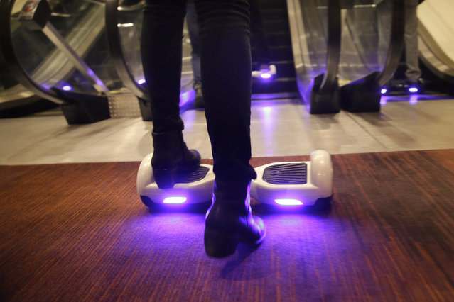 A woman rides an IO Hawk, a self-balancing motorized personal transporter at the International CES, Monday, January 5, 2015, in Las Vegas. (Photo by John Locher/AP Photo)