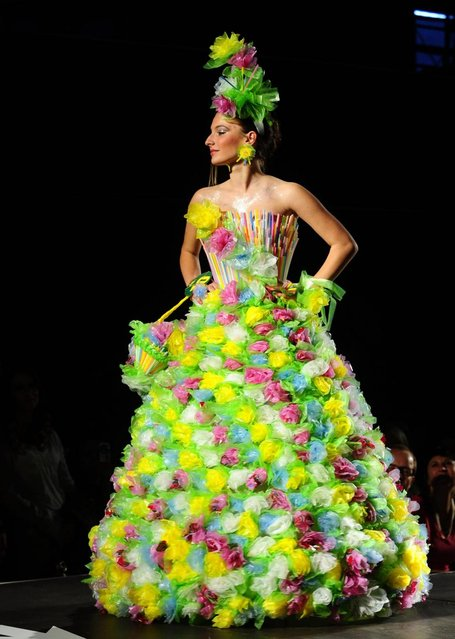 A model presents a creation made of plastic bags and straws during Trash Fashion Show in Macedonia's capital Skopje, on Wednesday, June 5, 2013. Teams from 47 high schools from Macedonia participated in the show with creations made of redesigned materials from waste such as plastic bags, newspapers, cardboard, plastic bottles, cans, used paper, etc. (Photo by Boris Grdanoski/AP Photo)